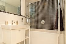 New, large, private bathroom featuring Villeroy & Boch fittings. Shower, bath, heated towel rail and two large mirrors.