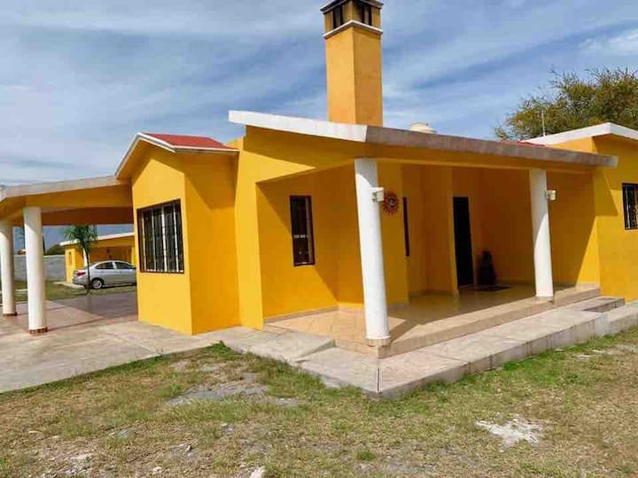 House with 2 bedrooms, kitchen & living room.