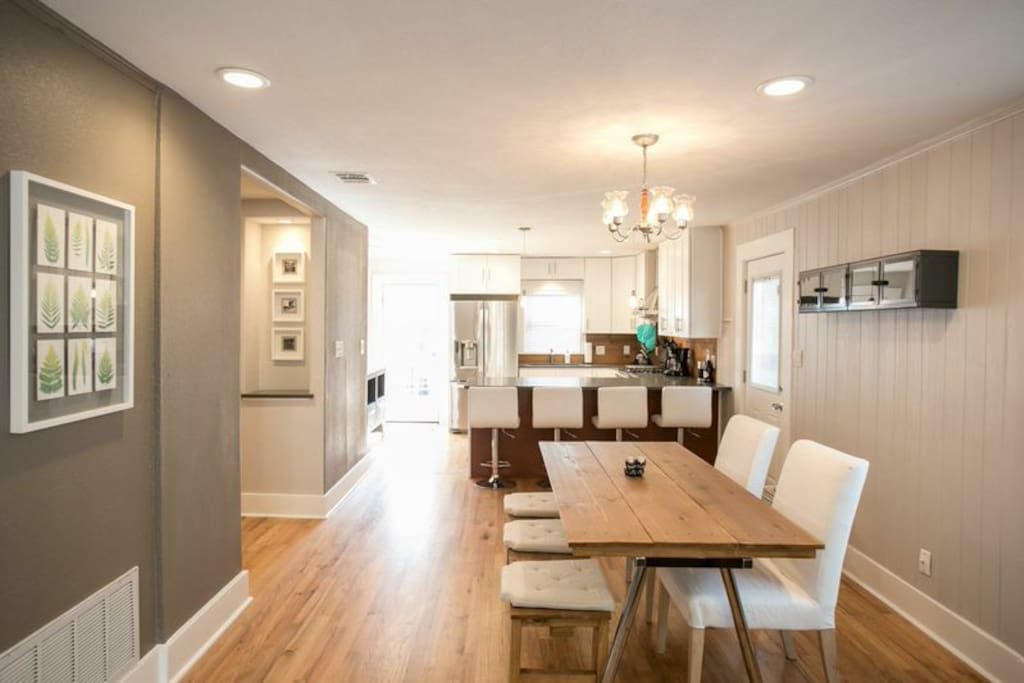 Bright, contemporary and open kitchen and dining space with recessed LED lighting throughout.