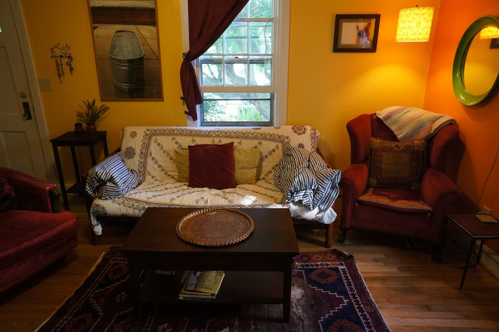 Cozy living room with books, blankets and board games. Futon folds out to 3rd bed.