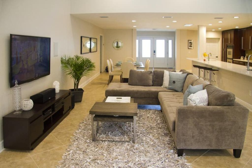 Living area with vaulted ceiling and open plan