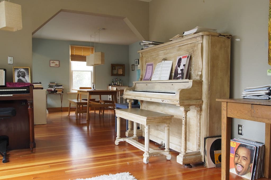 shared living room and dining room, with piano and Hammond organ