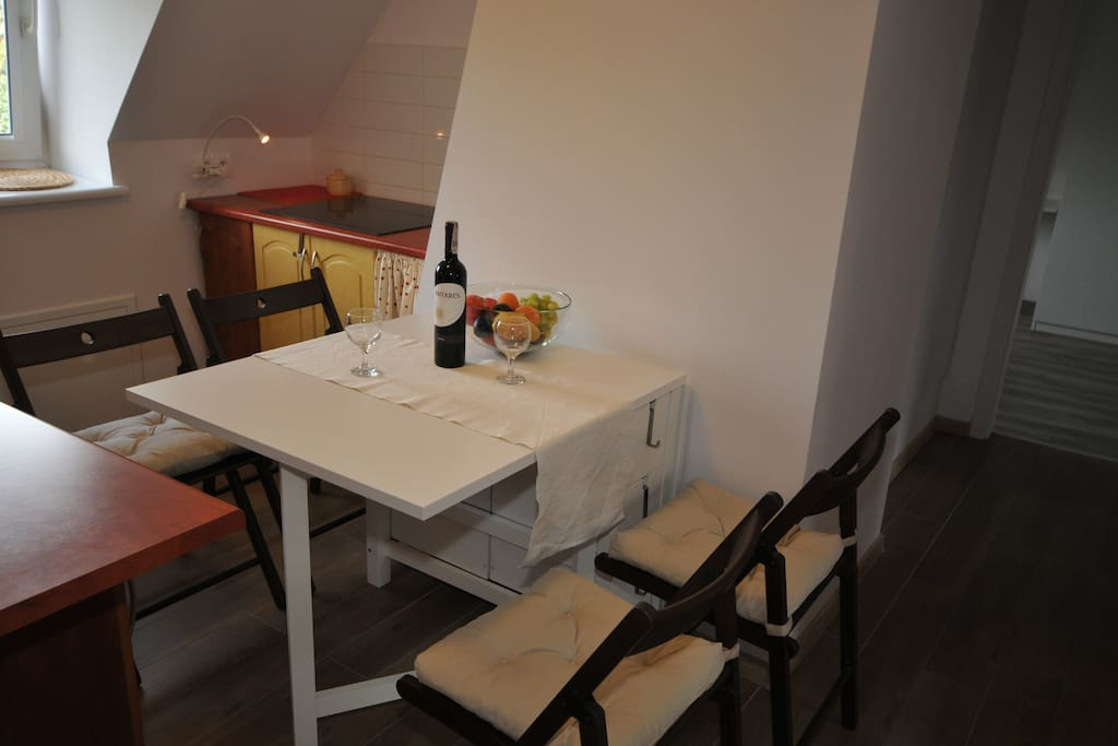 kitchen with a table for 4 persons