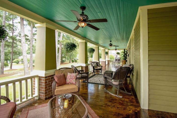 Large wrap around porch full of southern hospitality