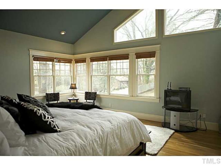 The master bedroom looks out over the backyard.