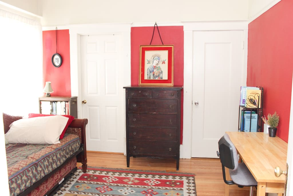 The RED ROOM- one door to the bathroom, the other door to the closet