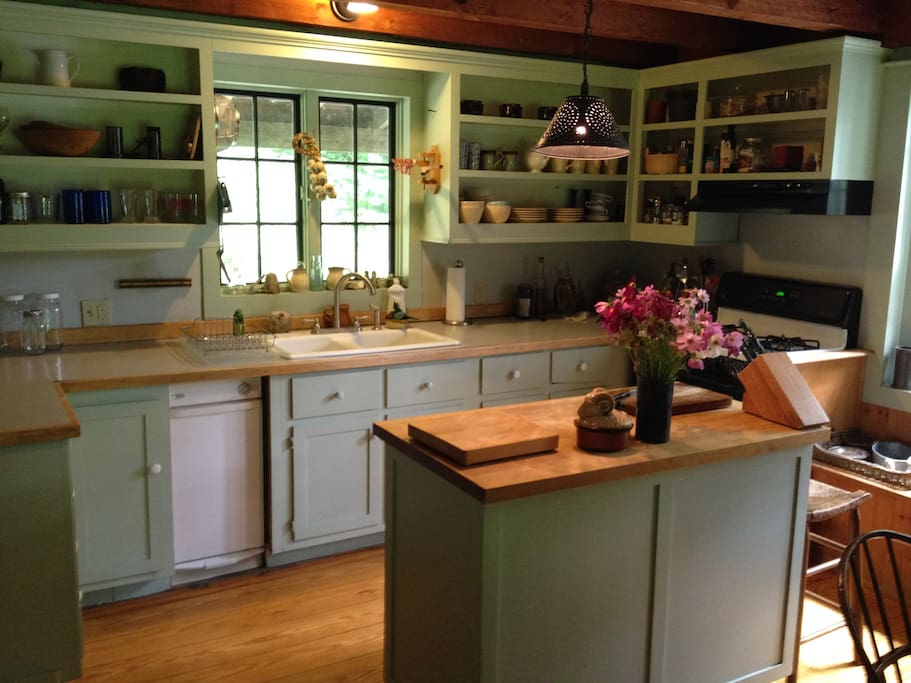 country kitchen with island, window seat and breakfast table