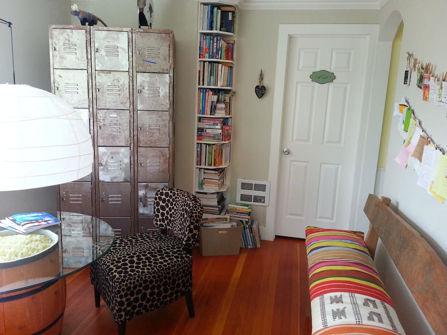 view of the living room from the back door looking towards the sunrise room and bookcase.