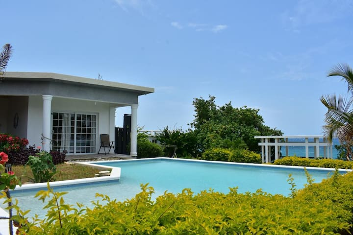 Courtyard with pool overlooking the ocean.