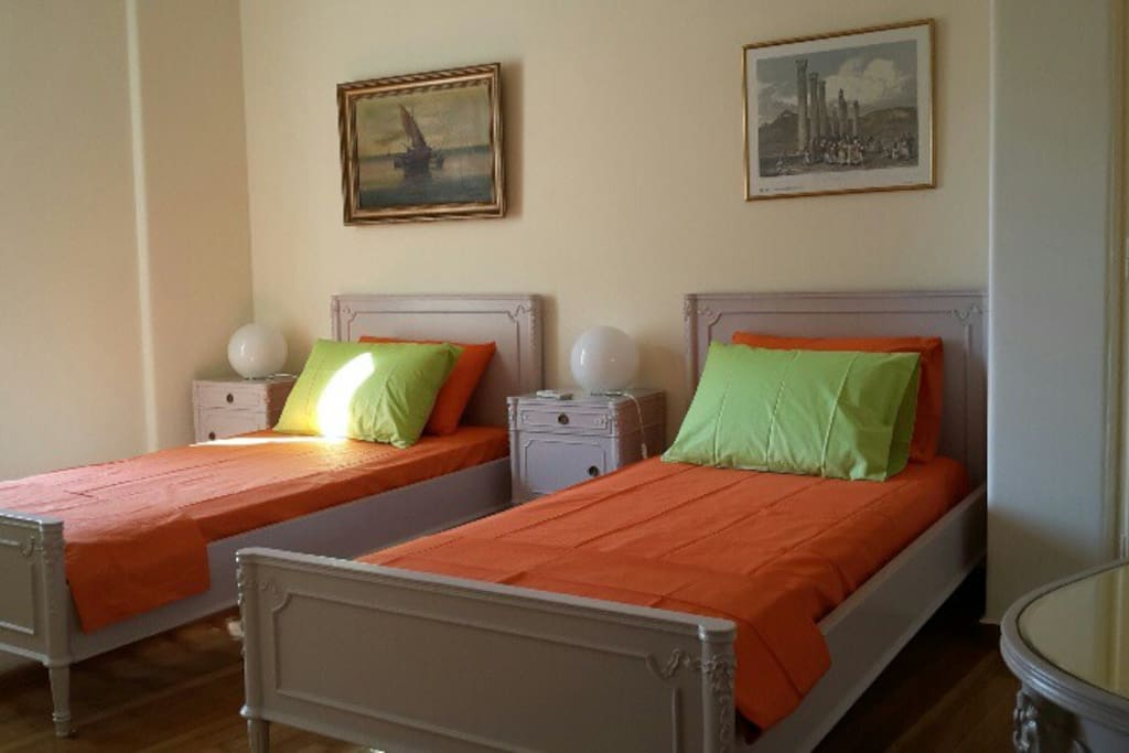 the bed room with the two single beds