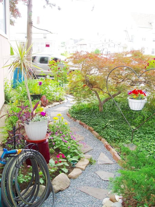 Back of house garden and entrance to apartment.
