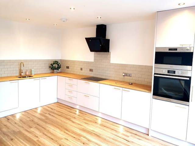 Large Kitchen Dinning area, Blush and gold is the colour scheme. capable of seating 7 easily, with large bi-fold doors to outside. Come with Coffee machine and all items for you to make a family meal.
