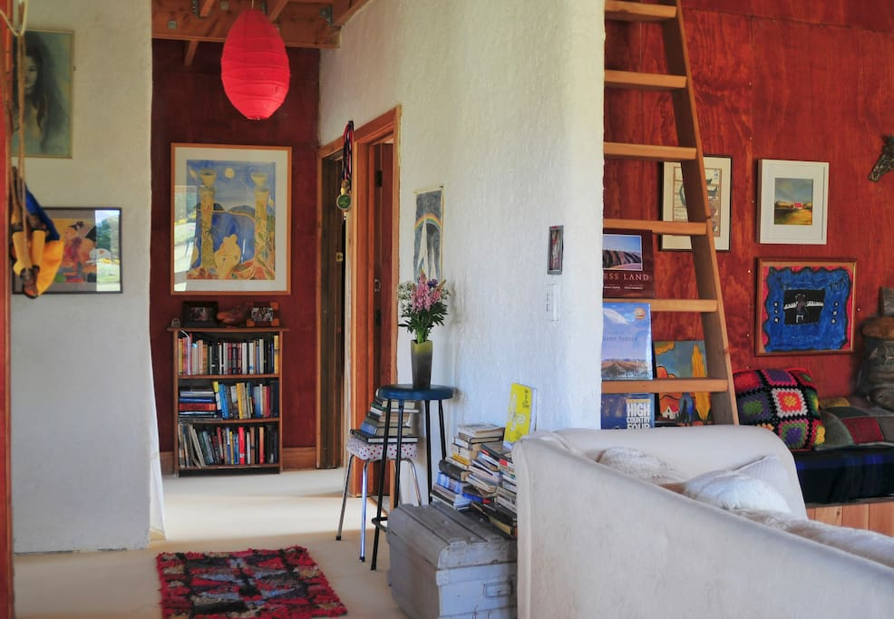 Artwork, books and lime washed walls.