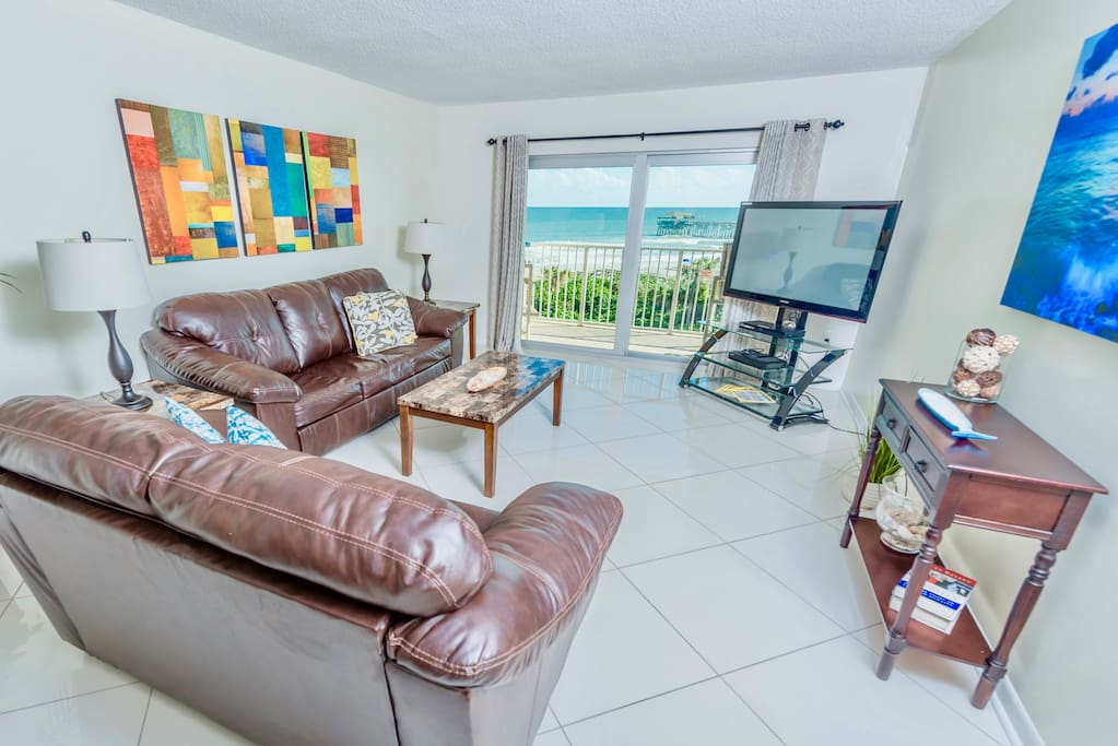 Bright living room with outstanding views and a big screen TV.