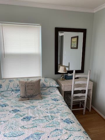 Main floor bedrooms have desks for taking care of business while you're enjoying the beach.
