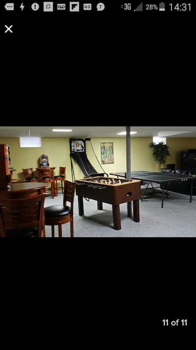 This lower level has the works!!! Huge HD TV, bar, poker table, ping pong table, fooseball, and more! Perfect gathering place for that special corporate retreat, family reunion and/or friends, old and new! Game on!!