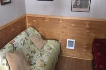 Queen bed futon couch, wall heater and Smart TV.