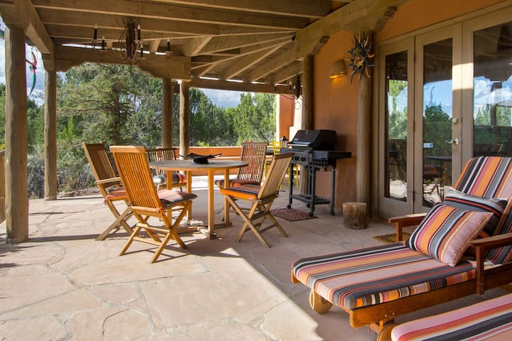 An incredible covered patio overlooks the beautifully landscaped property.