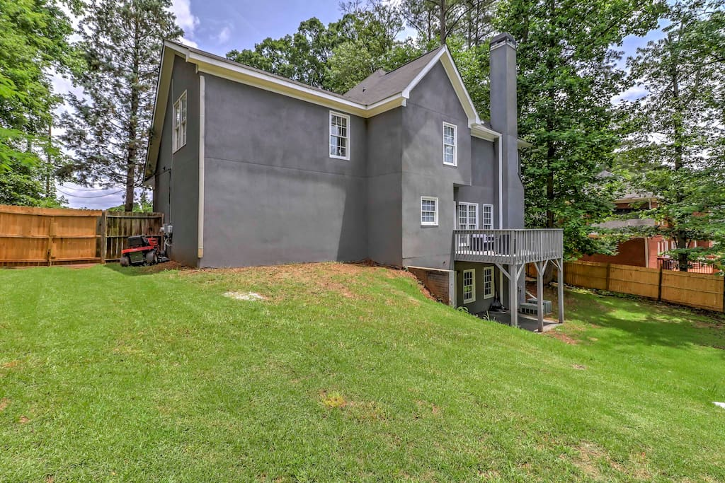 The home features a spacious, fenced-in backyard, perfect for kids.
