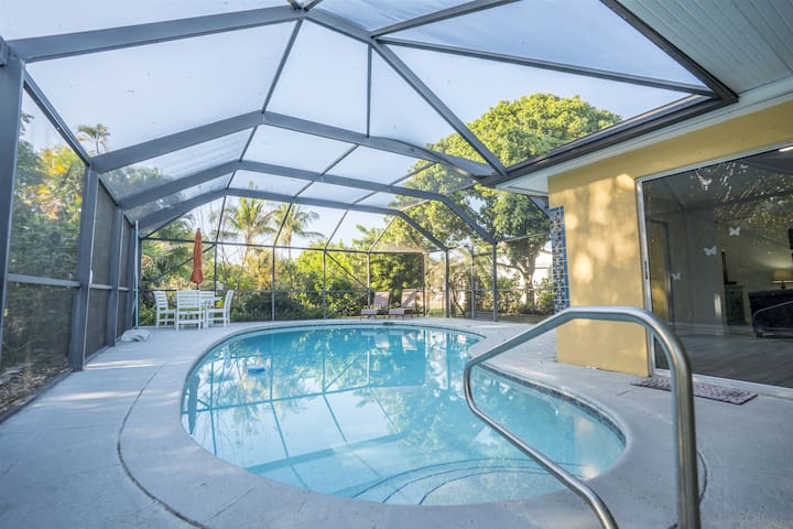 Newly renovated  home, screened optional heated Pool, Lush diverse Gardens, near Beach, lakefront property, extensive wildlife, fishing, top reviews experienced Suporhost, rent from onwer/manager