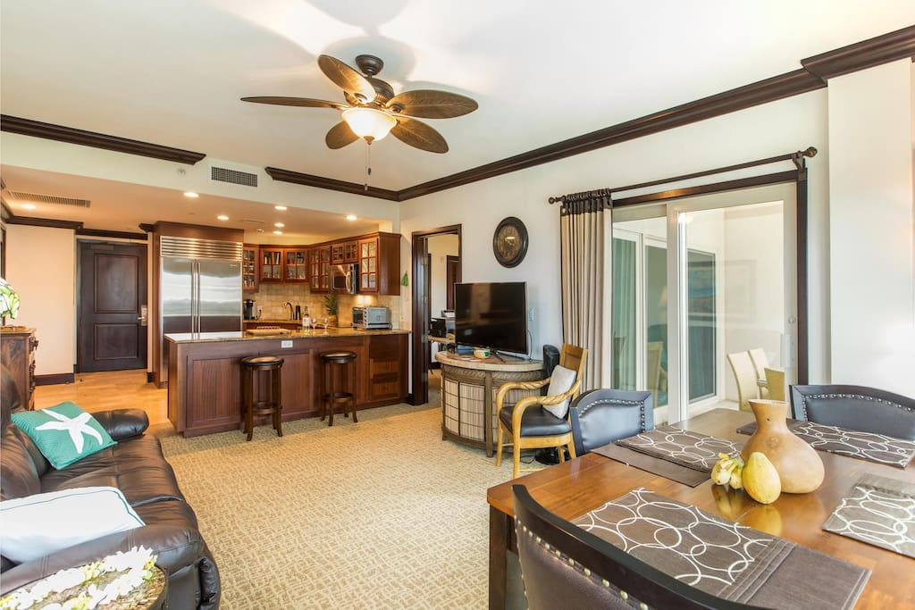 """Living room with a double recliner couch (no sofa sleeper!) And 48"""" flat screen TV!"""