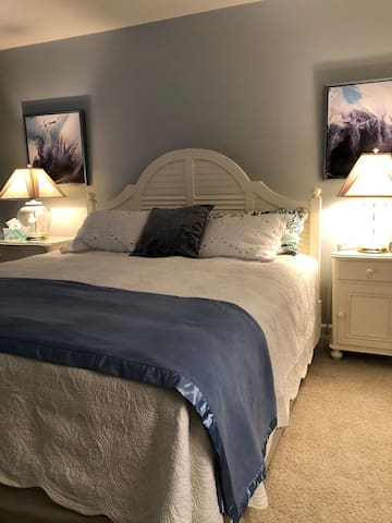 King bed with armoire and TV