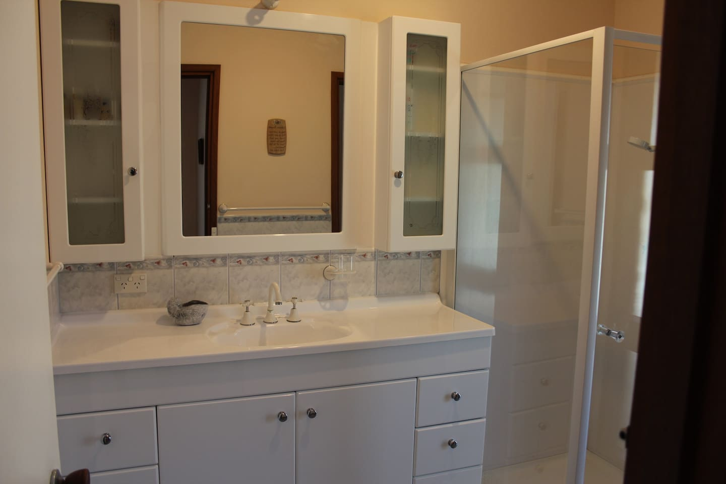clean and spacious bathroom with power points for hairdryer