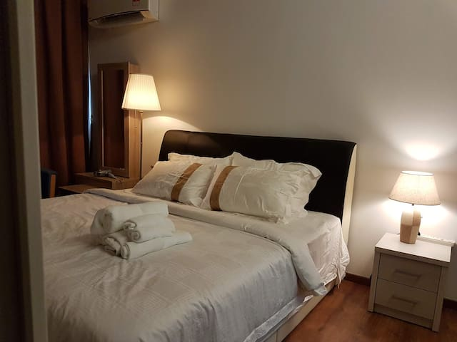 IMAGE 1 masterbed room with king size bed with wardrobe with hangers, iron, hair dryer & fully aircon