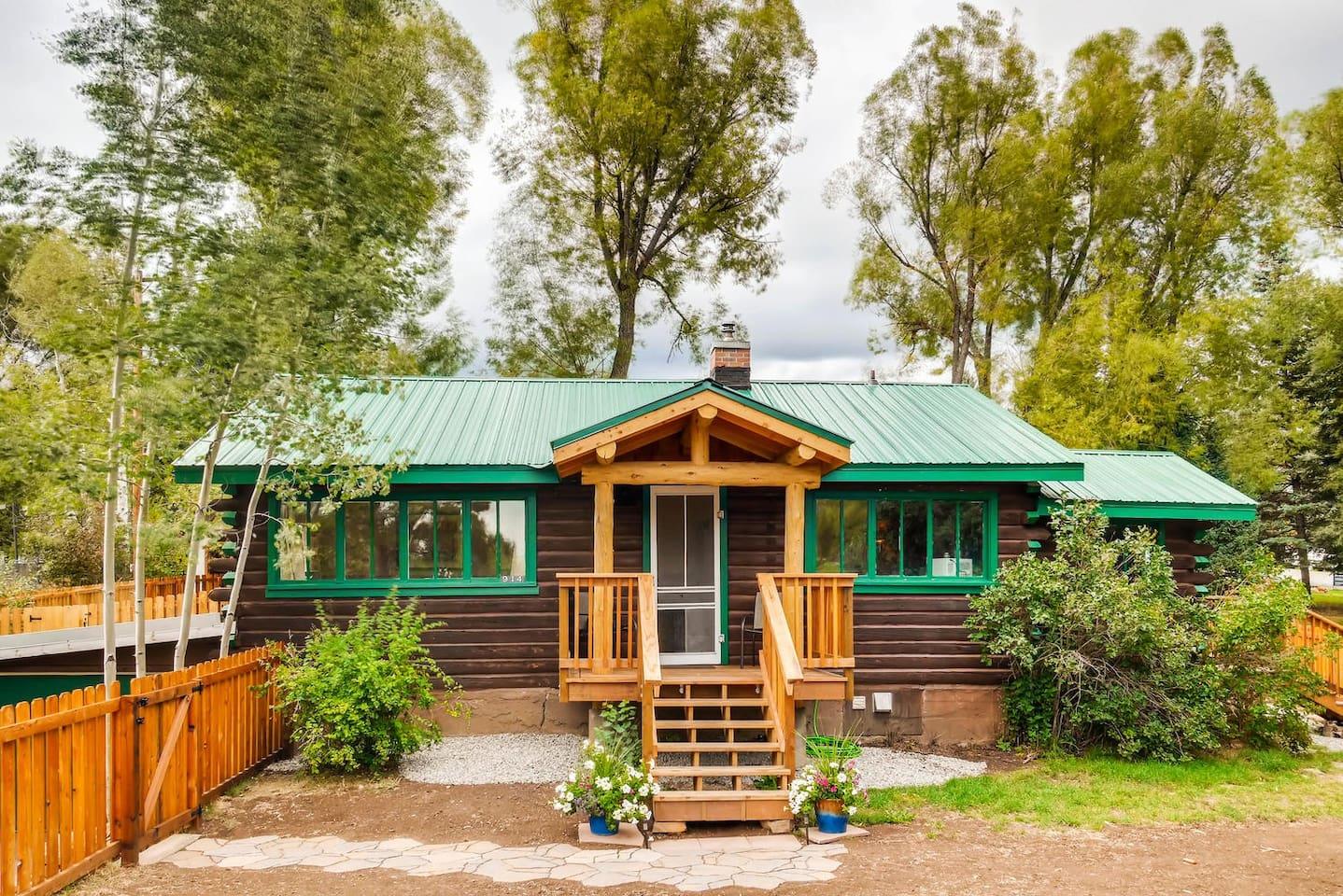 Wonderfully restored historic Old Town Log Cabin with big back deck & huge fenced yard