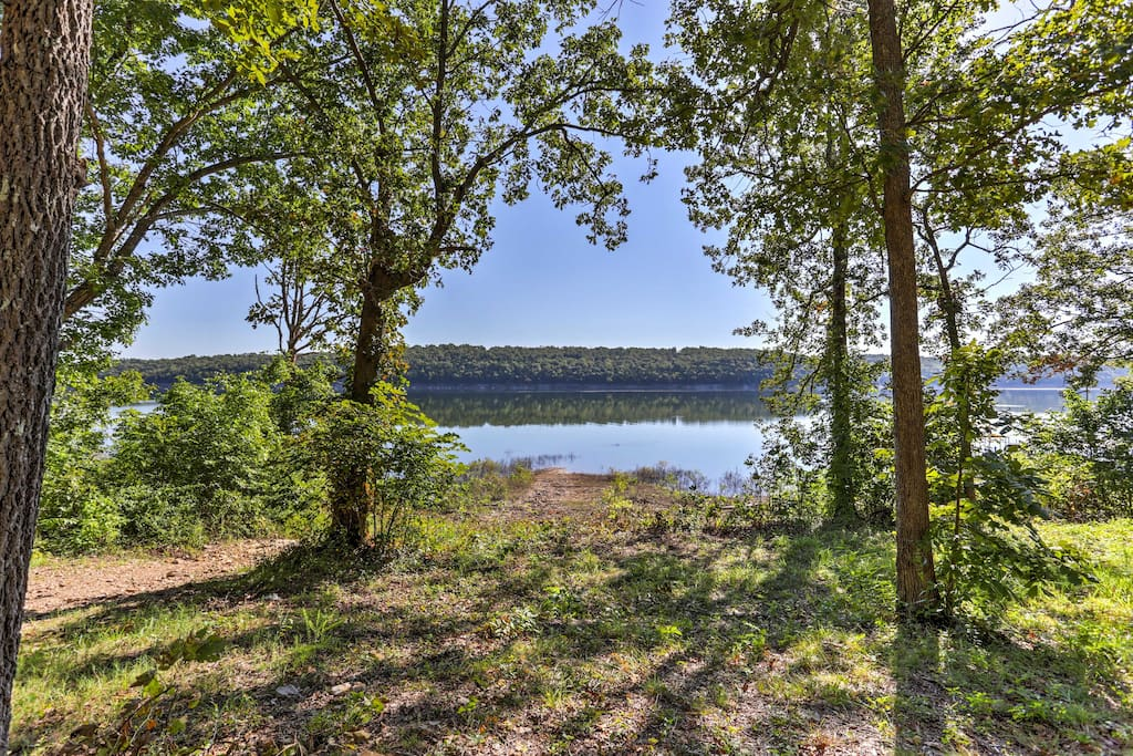 The cabin is located on Bull Shoals Lake and has incredible views of the water from the front yard!