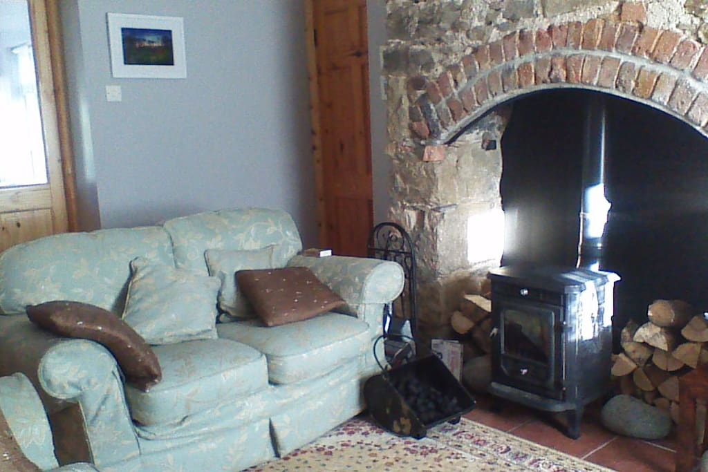 Old stone fireplace with cast iron stove