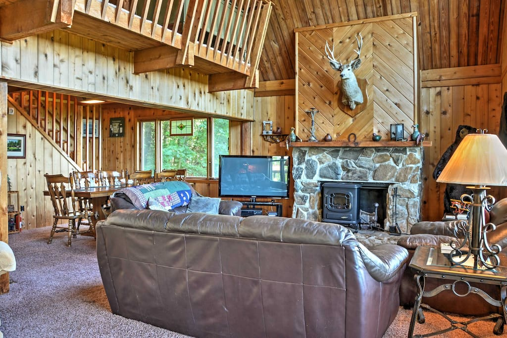 The interior is tastefully outfitted with rustic wood paneling and mountain inspired decor.