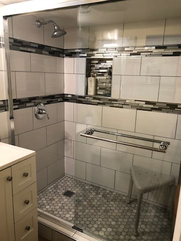 Extra large shower with a stool to accommodate your experience