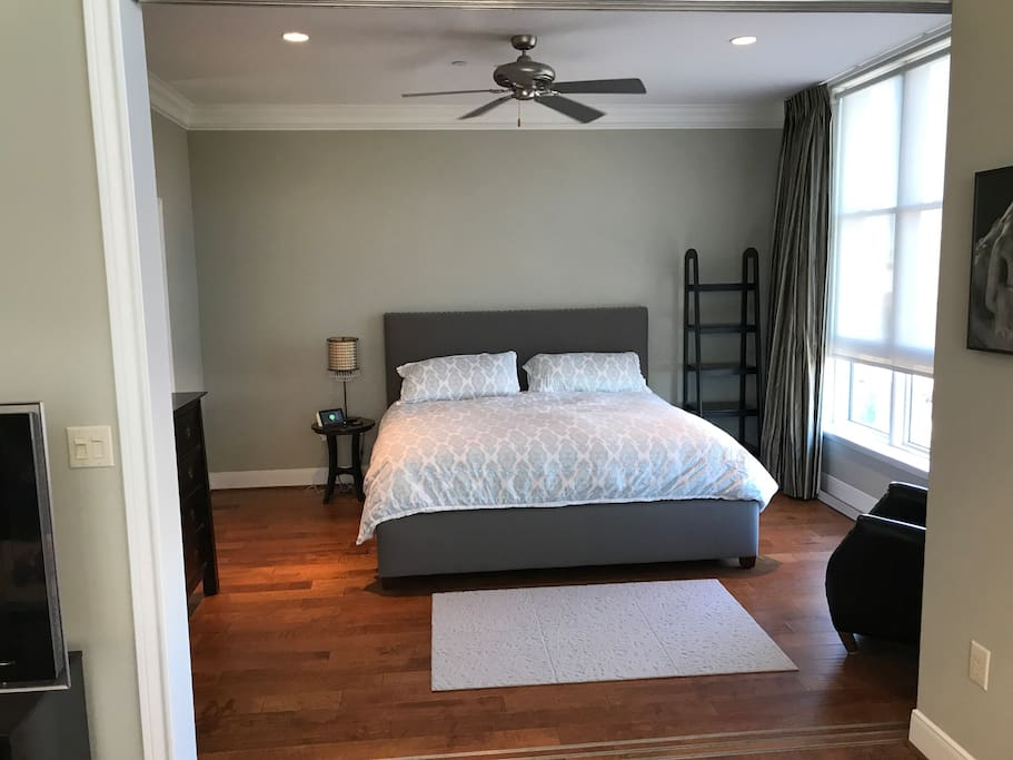 Master bedroom off the main living room with king size bed. This room is isolated from the main living room by a set of 3 sliding doors.