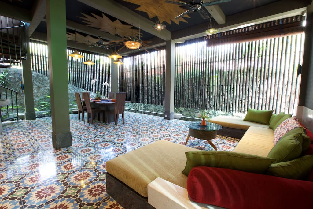 main villa entrance with handmade-tile floors from central Java