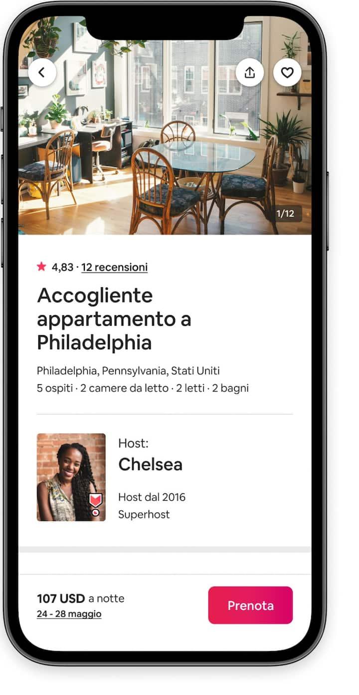 """Una schermata di pagamento degli ospiti dall'app di Airbnb con la foto di una cucina, i dettagli dell'host e il pulsante """"Prenota""""."""