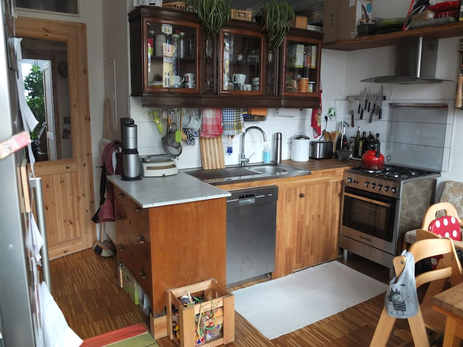 Kitchen with gas stove top and oven, dish washer