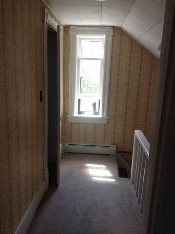 steps and hallway leading to room for during week only rate