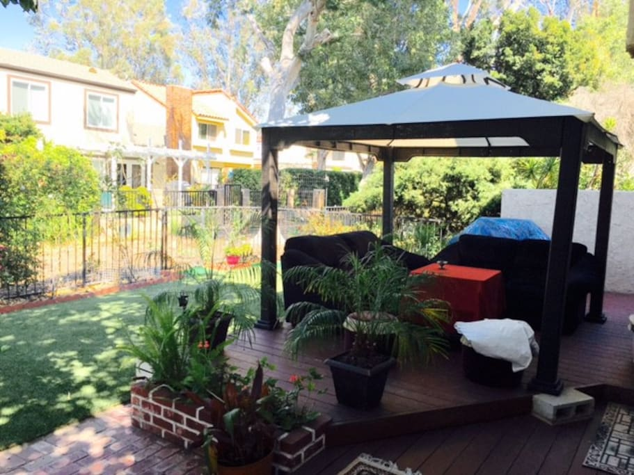 Cabana in backyard to relax and enjoy the outdoor space and work in as well