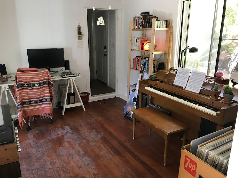 """""""The Den"""" complete with a desk, 27-inch monitor, piano and stereo with a record player"""