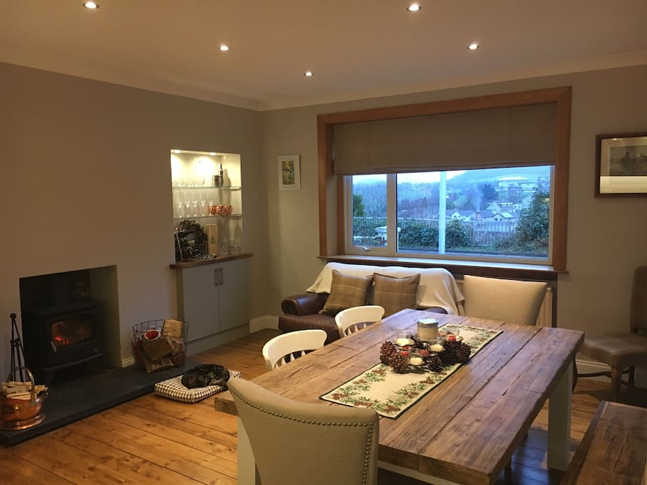 Cozy kitchen diner with log burner and nice view