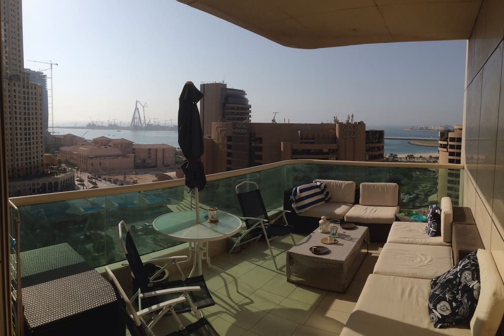 """Enjoy your morning coffee on the spacious terrace. It is truly a terrace, not just a balcony (Update on """"Dubai Eye"""" progress - as seen in other pictures, the whole circle - except one last piece - is now assembled)"""