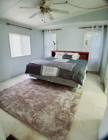 Nice bedroom in a mobile home.