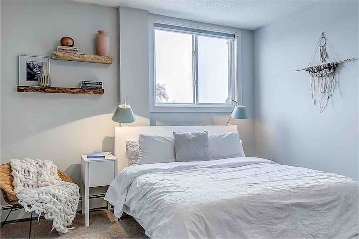 Cozy bedroom with a full length mirror. Additional bedding can be found in the dresser.