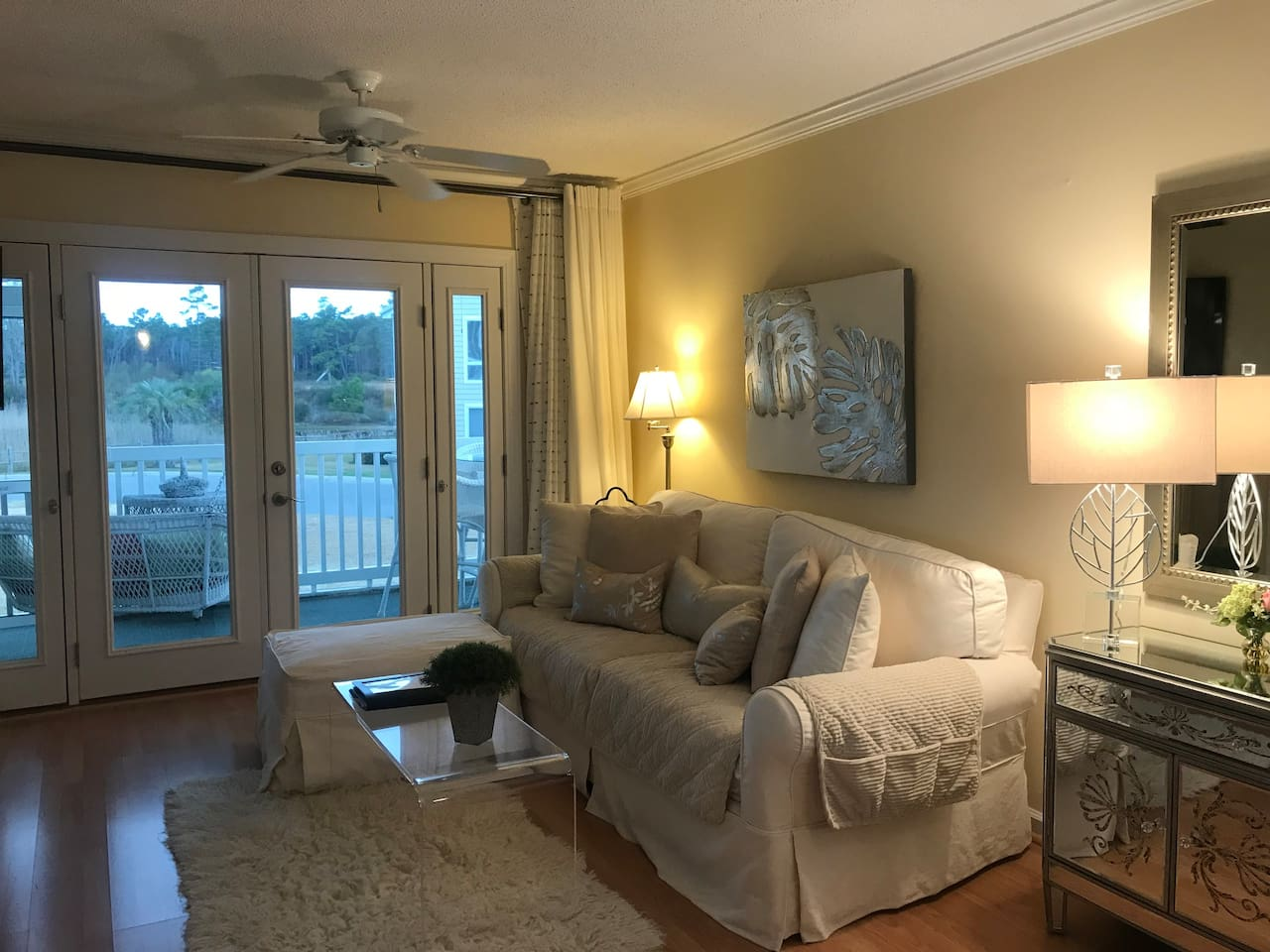 Bee's Waterway Getaway offers a limited view of the ICW, comfortable designer seating, and a screened in porch with a sturdy swing to take a nap. The best of both worlds... Waterway, expansive green areas, & less than a mile to the beach.