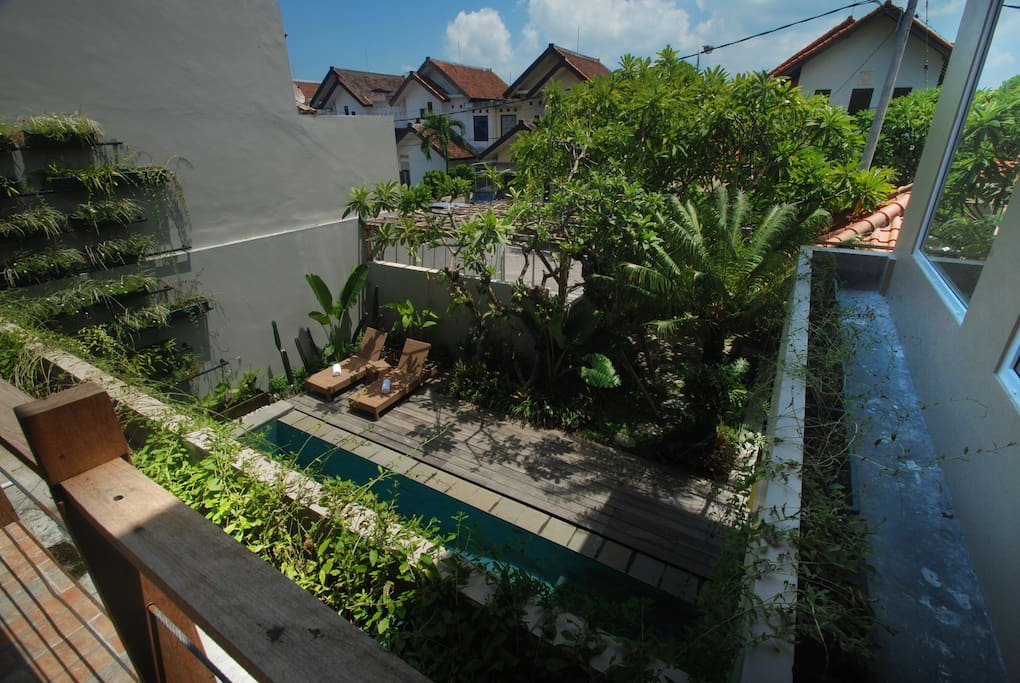 THE VIEW OF SWIMMING POOL FROM SECOND FLOOR