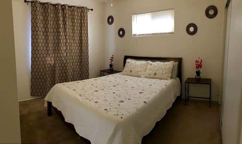 Queen size bed in cute cozy room