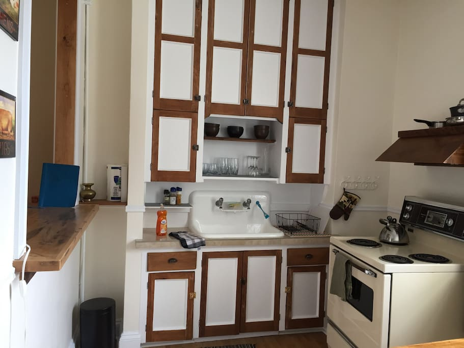 The fully equipped kitchen showing the custom built and restored wooden features.