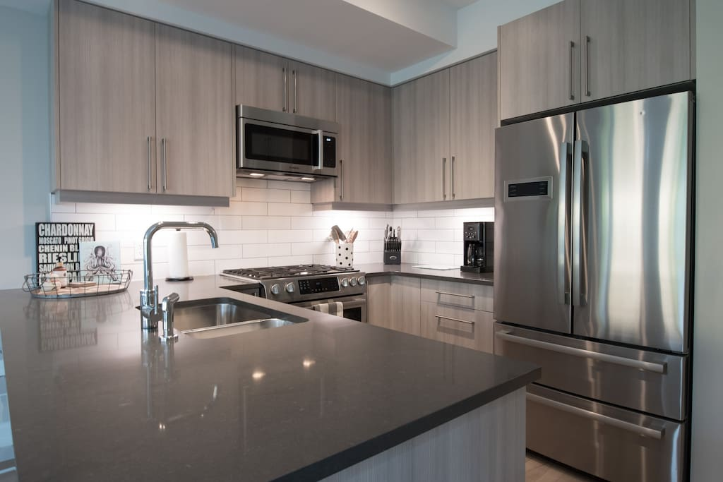 Stainless steel appliances including a gas range.
