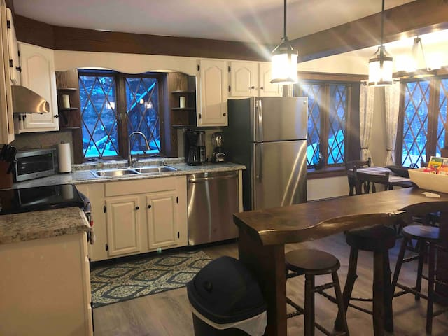 The kitchen is fully stocked with brand new appliances, several small appliances, dishes, cooking and baking pans, hot beverages, spices and oils.